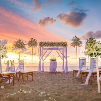 beach ceremony setup with colorful sky